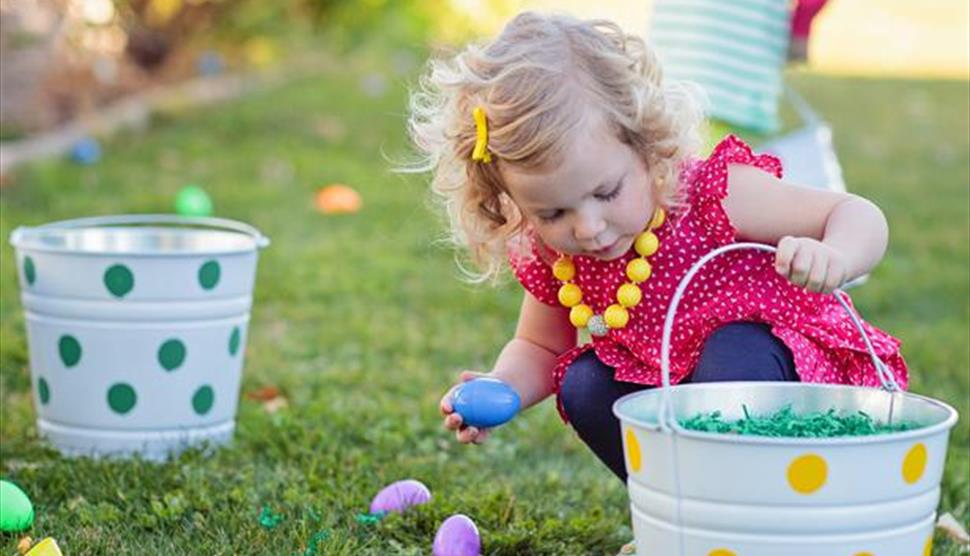 Child gathering Easter eggs